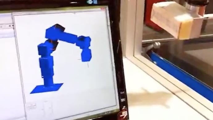 Watch An Industrial Robot, programmed with MATLAB and Simulink writes a surprise message on a glass panel.